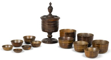 A ENGLISH TURNED LIGNUM VITAE STANDING CUP AND COVER, MID-17TH CENTURY