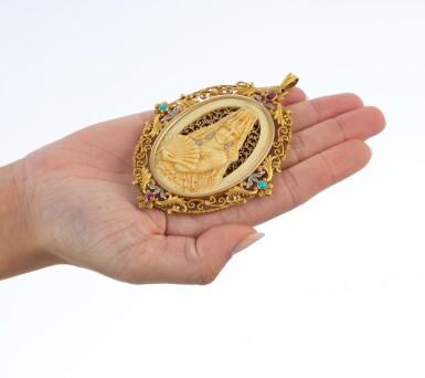 View 4. Thumbnail of Lot 22. Pendentif ivoire, corne, pierres de couleur et diamants   Ivory, horn, gem set and diamond pendant.
