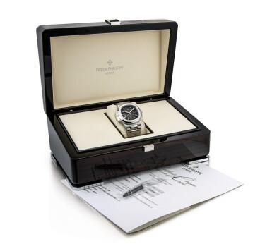 View 4. Thumbnail of Lot 2066. Patek Philippe | Nautilus, Reference 5990, A stainless steel dual time zone flyback chronograph bracelet watch with date, Circa 2014 | 百達翡麗 | Nautilus 型號5990   精鋼兩地時間飛返計時鏈帶腕錶,備日期顯示,約2014年製.