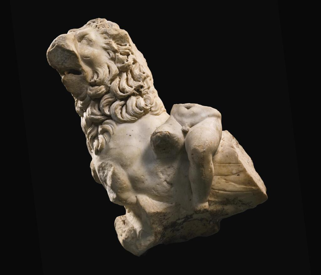 A FRAGMENTARY ROMAN MARBLE GROUP OF AN EROTE RIDING A SEA-LION, CIRCA 2ND CENTURY A.D.