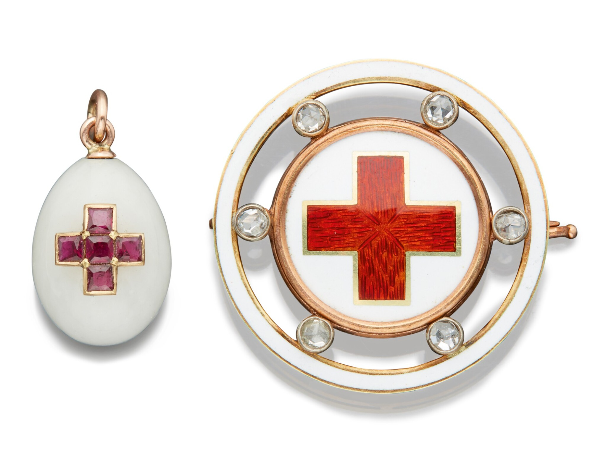 View full screen - View 1 of Lot 62. A FABERGÉ GOLD AND JEWELLED HARDSTONE EGG PENDANT AND A JEWELLED GOLD AND ENAMEL RED CROSS BROOCH, THE PENDANT, WORKMASTER MICHAEL PERCHIN, ST PETERSBURG, CIRCA 1890; THE BROOCH, WORKMASTER AUGUST HOLLMING, ST PETERSBURG, 1899-1903.