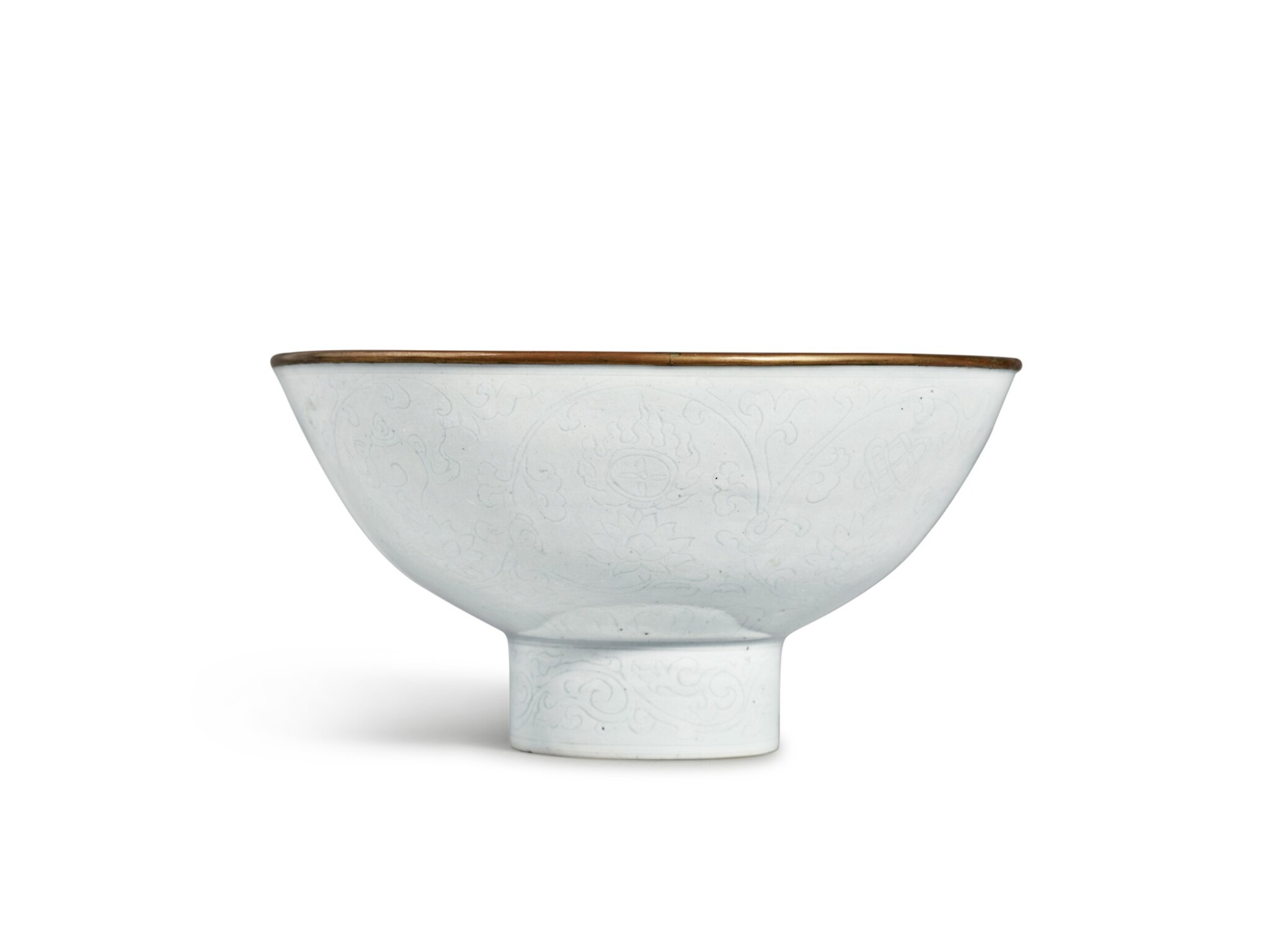 View full screen - View 1 of Lot 153. An exceptionally rare white-glazed 'Eight Buddhist Emblems' stem bowl, Mark and period of Xuande   明宣德 白釉暗花纏枝蓮托八吉祥紋高足盌 《大明宣德年製》款.