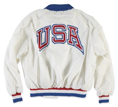 View 2. Thumbnail of Lot 1107. U.S. OLYMPIC COMMITTEE | PERSONALIZED OLYMPIC WINDBREAKER AND COMMEMORATIVE PLAQUE.