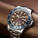 REFERENCE 1680 SUBMARINER A STAINLESS STEEL AUTOMATIC WRISTWATCH WITH DATE, BRACELET AND TROPICAL DIAL, CIRCA 1970