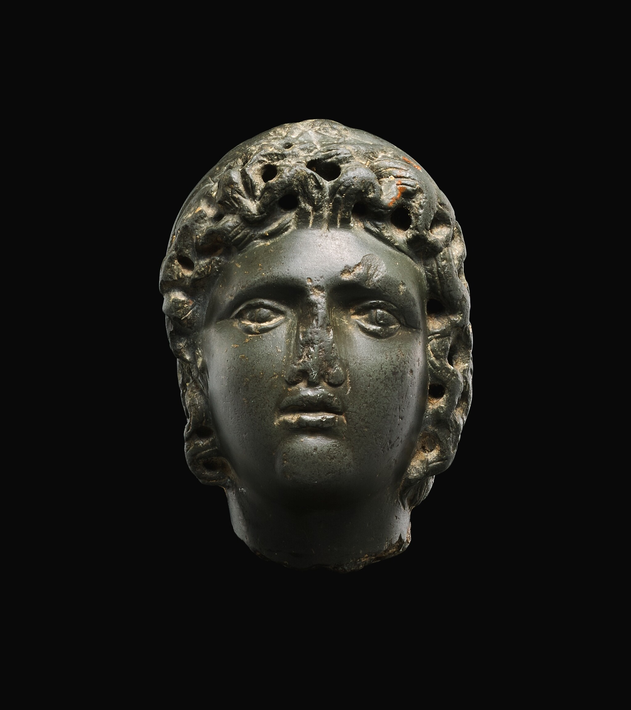 View full screen - View 1 of Lot 26. A ROMAN GRAYWACKE HEAD OF A YOUTH, CIRCA 2ND CENTURY A.D..