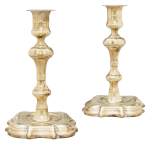 PAIR OF CHIPPENDALE CAST-BRASS CANDLESTICKS, 18TH CENTURY