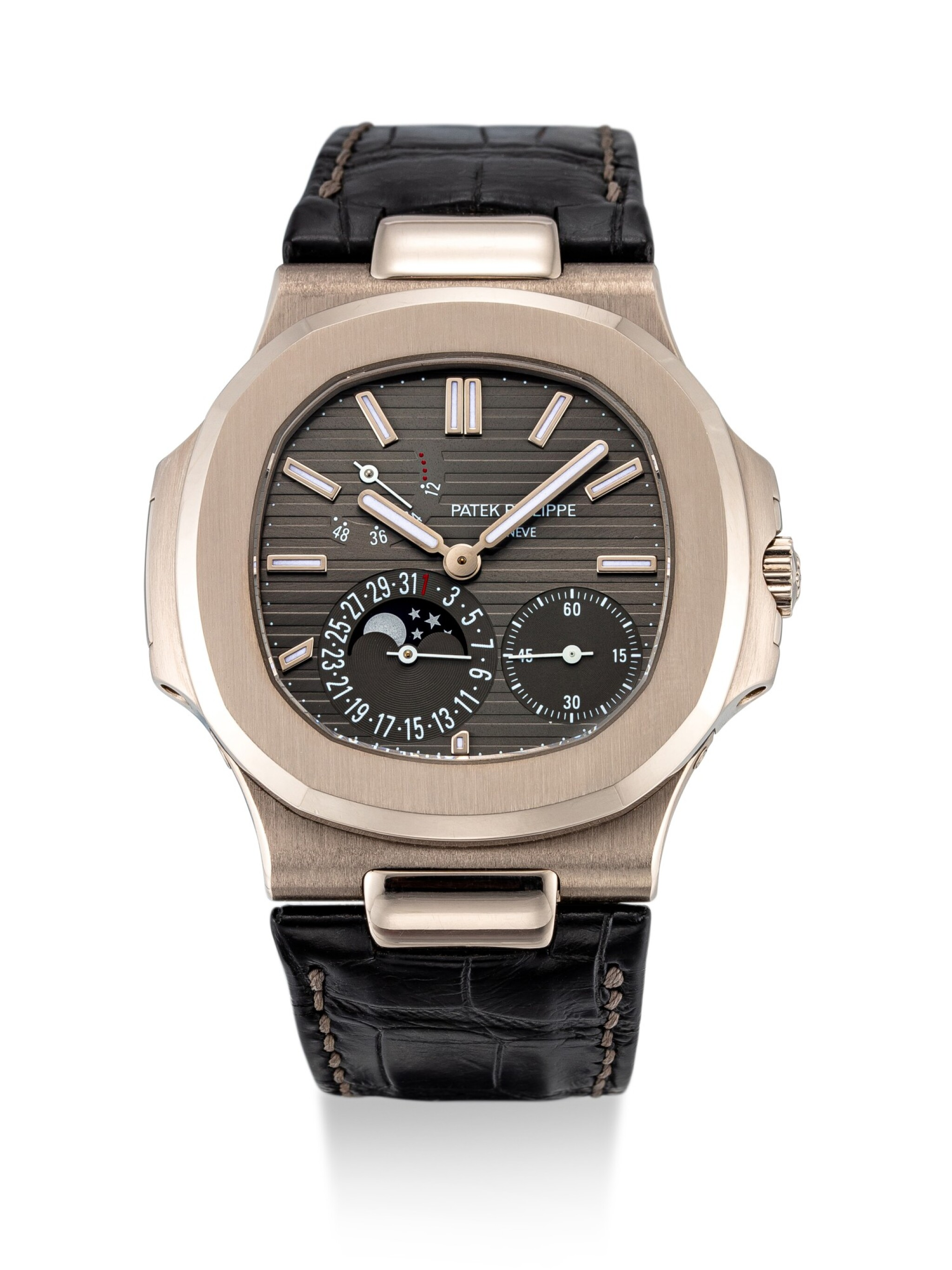 View 1 of Lot 8008. Patek Philippe | Nautilus, Reference 5712, A white gold wristwatch with date, moon phases and power reserve indication, Circa 2016 | 百達翡麗 | Nautilus 型號5712   白金腕錶,備日期、月相及動力儲備顯示,約2016年製.