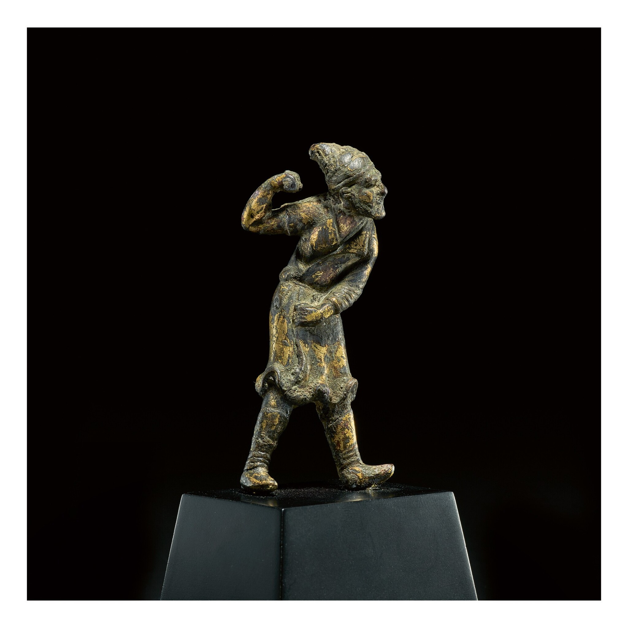 View full screen - View 1 of Lot 581. A SMALL GILT-BRONZE FIGURE OF A SOGDIAN GROOM,  TANG DYNASTY.