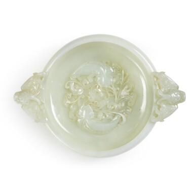 View 1. Thumbnail of Lot 7. A white jade marriage bowl, Qing dynasty, 18th / 19th century   清十八 / 十九世紀 白玉雕年年有餘紋龍耳活環洗.