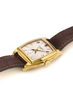 PATEK PHILIPPE | REF 5135J GONDOLO CALENDARIO, A YELLOW GOLD TONNEAU FORM AUTOMATIC ANNUAL CALENDAR WRISTWATCH WITH MOON PHASES MADE IN 2005
