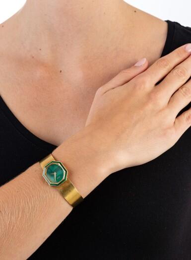 View 4. Thumbnail of Lot 74. Piaget | Montre de dame or et malachite | Lady's gold and malachite bracelet watch.