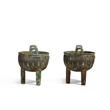 View 4. Thumbnail of Lot 1. An extremely rare pair of archaic bronze ritual food vessels (Ding), Late Shang dynasty   商末 子龔鼎一對.