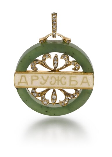 View 1. Thumbnail of Lot 69. A Fabergé jewelled gold-mounted and guilloché enamelled nephrite pendant, Moscow, 1899-1908.