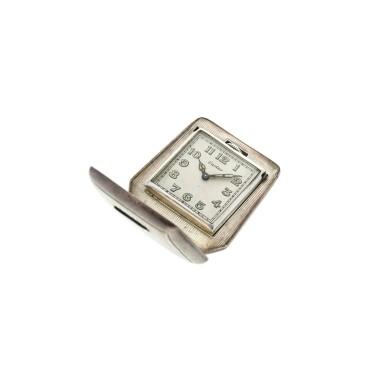 View 4. Thumbnail of Lot 100. A silver purse shaped travel clock, Circa 1930.