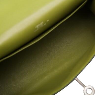 View 7. Thumbnail of Lot 17. Hermès Vert Anis Lizard Mini Kelly Pochette.