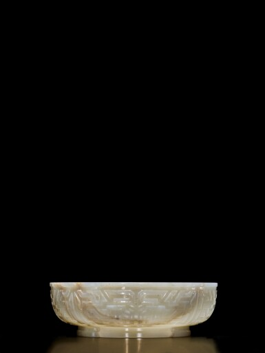 View 5. Thumbnail of Lot 62. An extremely rare inscribed archaistic celadon jade 'twin fish' basin, Mark and period of Qianlong | 清乾隆 青玉雕雙魚盤 《大清乾隆倣古》款.