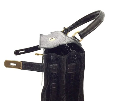 View 18. Thumbnail of Lot 743. HERMÈS | BLACK KELLY 28 IN SHINY CROCODILE WITH GOLD HARDWARE, 1962.