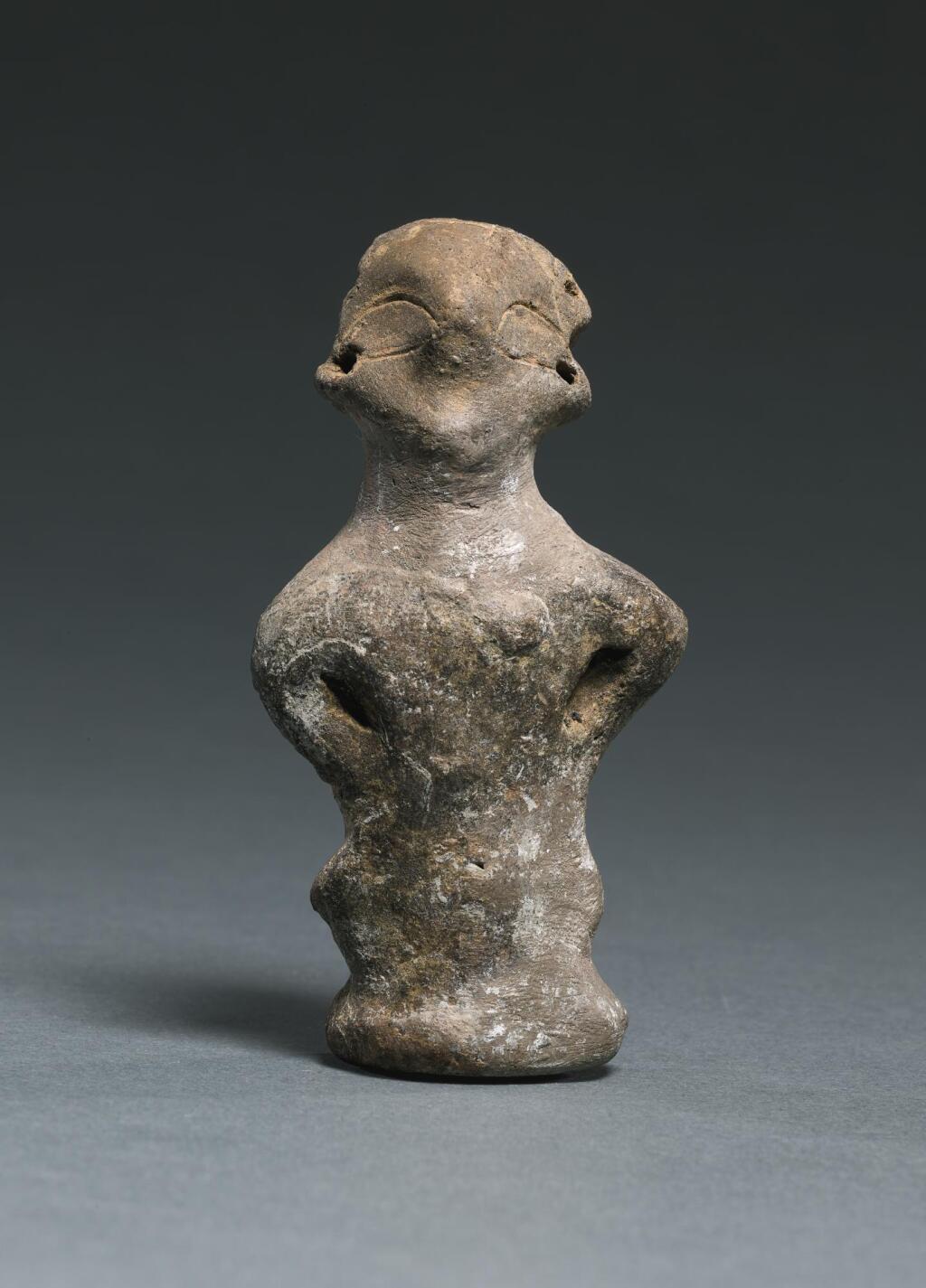 A VINČA TERRACOTTA FIGURE OF A WOMAN, NEOLITHIC PERIOD, VINČA C-D, VINČA-PLOČNIK-PHASE I, 5000-4500 B.C.