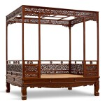 AN EXCEPTIONAL AND RARE HUANGHUALI SIX-POST CANOPY BED MING DYNASTY, 17TH CENTURY | 明十七世紀 黃花梨六柱透雕螭龍瑞獸紋圍子架子床