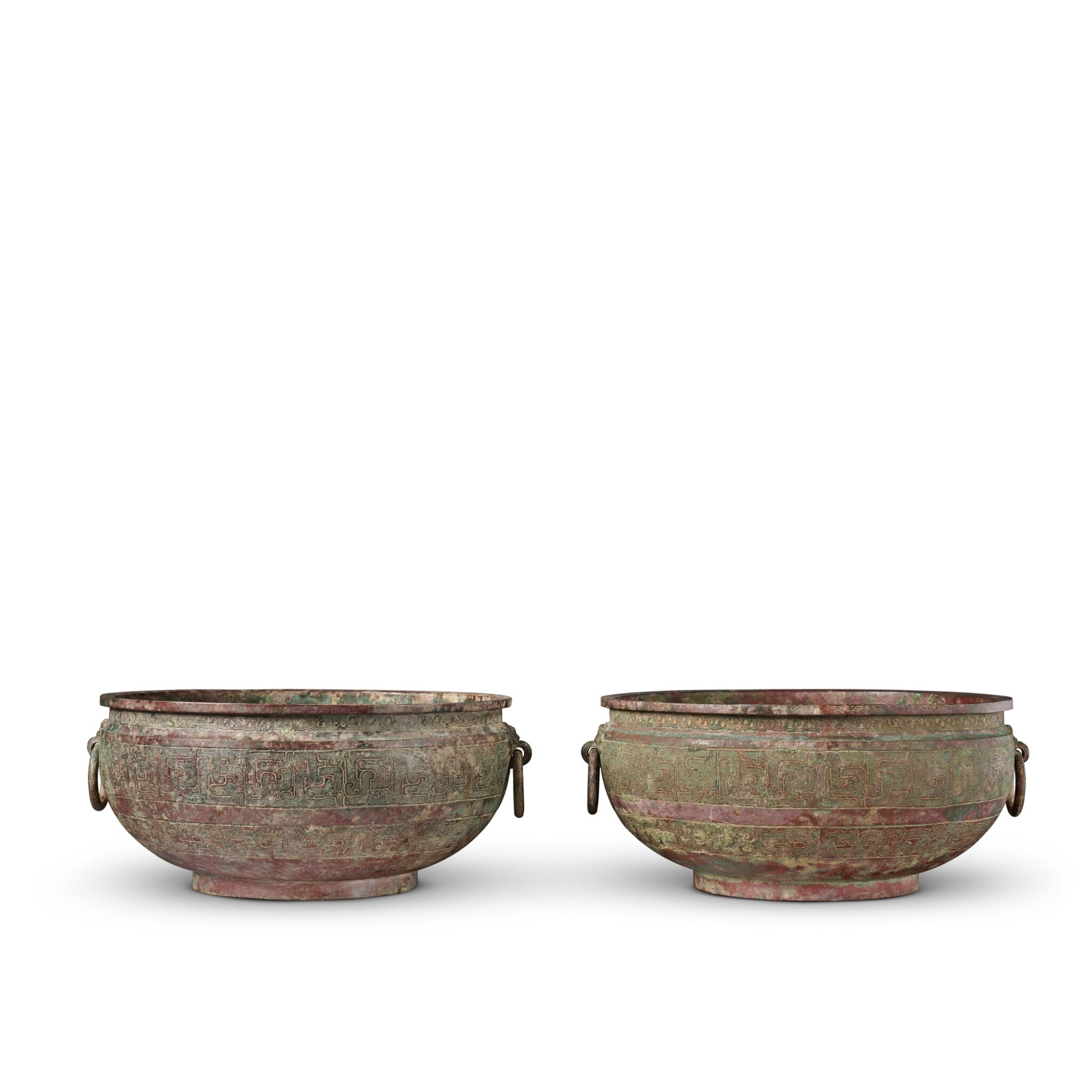 View full screen - View 1 of Lot 16. A pair of archaic bronze water basins (Jian), Eastern Zhou dynasty, late 6th - early 5th century BC   東周 公元前六世紀末至五世紀初 青銅交龍紋鋪首耳鑒一對.