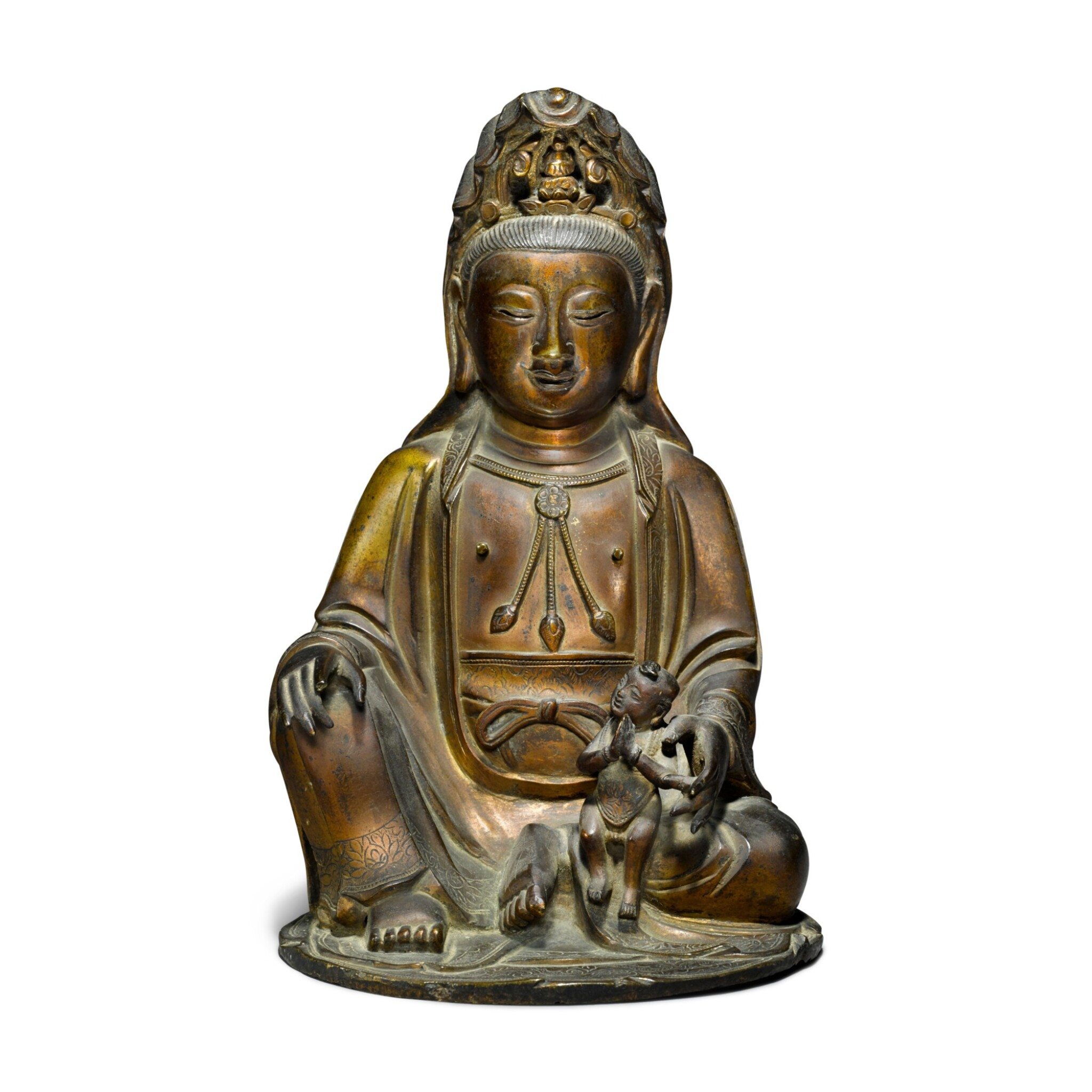 View full screen - View 1 of Lot 43. A gilt-bronze figure of Guanyin and child, Ming / early Qing dynasty.