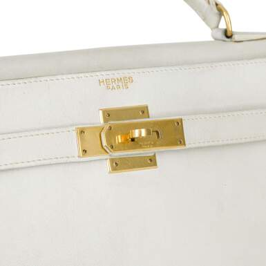View 5. Thumbnail of Lot 12.  HERMÈS | WHITE VINTAGE KELLY SELLIER 32 IN VACHE LEATHER WITH GOLD HARDWARE, CIRCA 1960s.