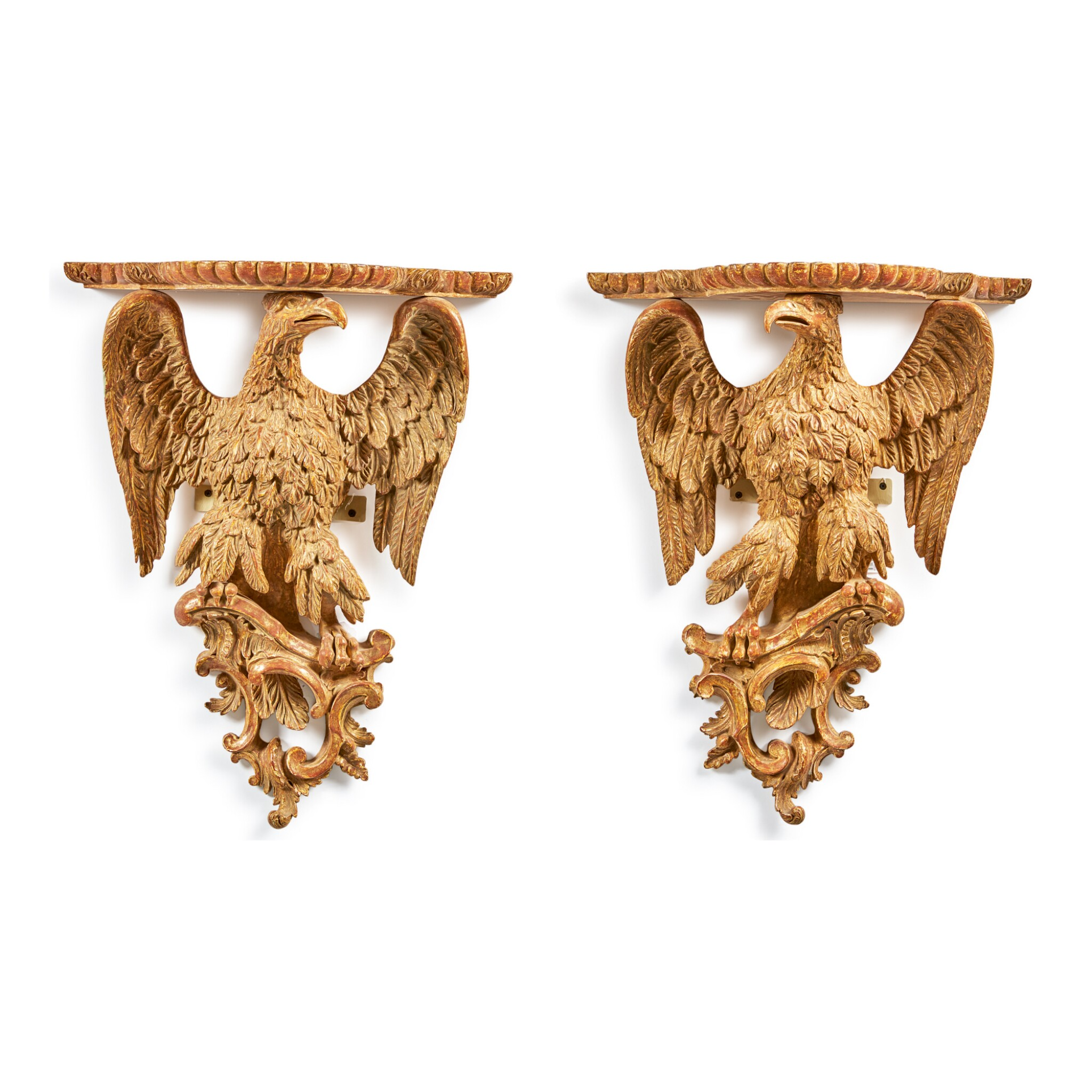 View full screen - View 1 of Lot 101. A PAIR OF GEORGE III GILTWOOD EAGLE-FORM WALL BRACKETS, CIRCA 1770.