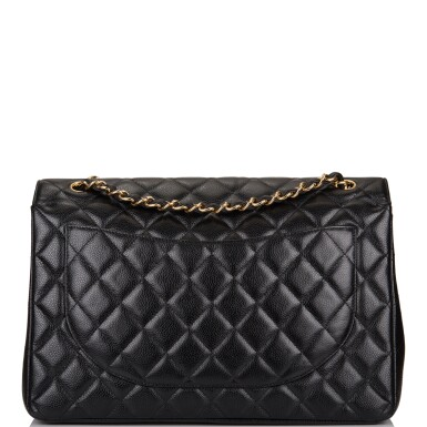 View 4. Thumbnail of Lot 60. Chanel Quilted Maxi Classic Double Flap Bag of Black Caviar Leather with Gold Hardware.