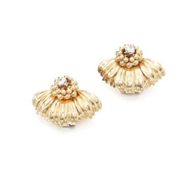 View 1. Thumbnail of Lot 102. Pair of gold and diamond ear clips.