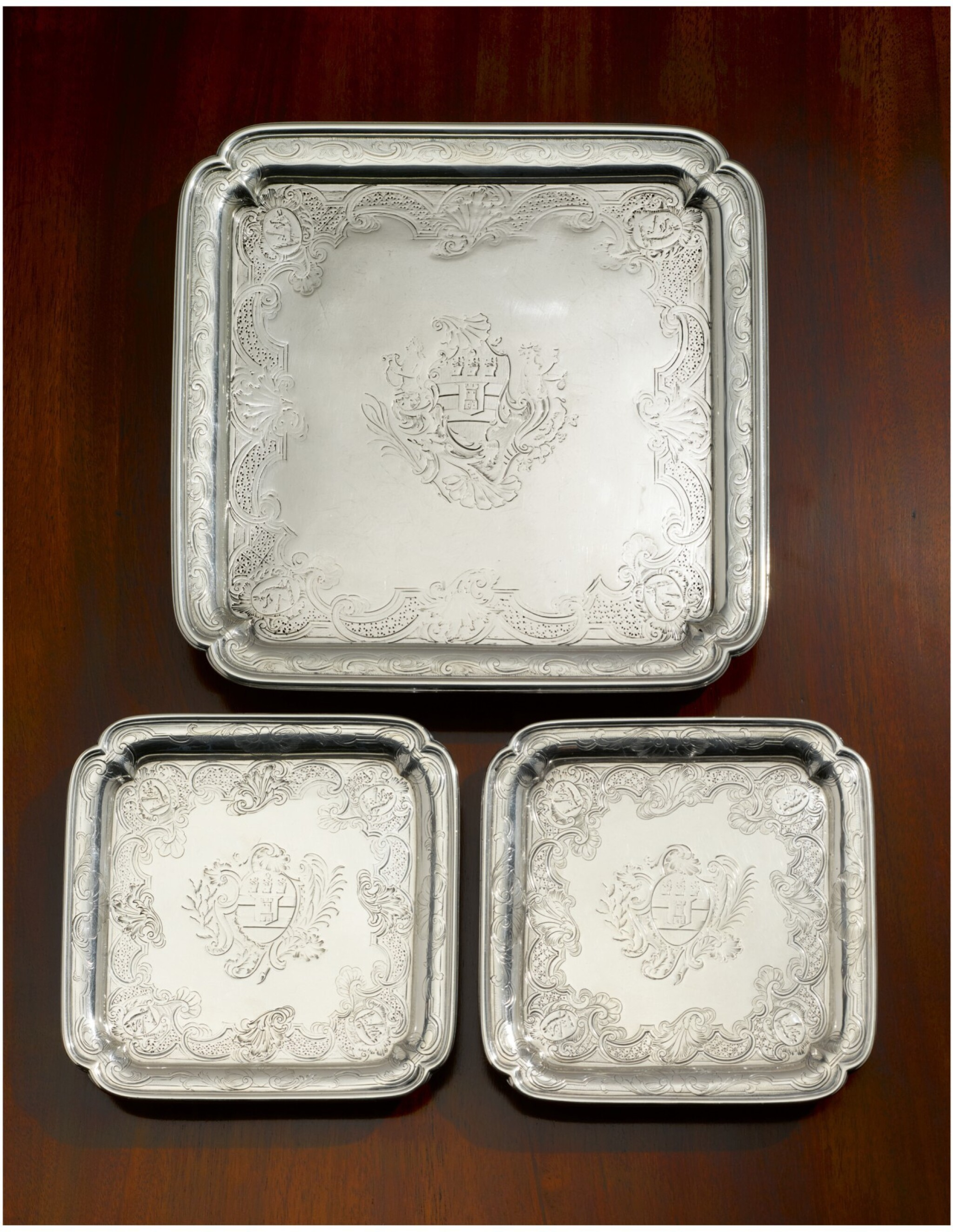 View full screen - View 1 of Lot 54. A GEORGE II SILVER SALVER AND PAIR OF MATCHING WAITERS, PAUL DE LAMERIE, LONDON, 1735.