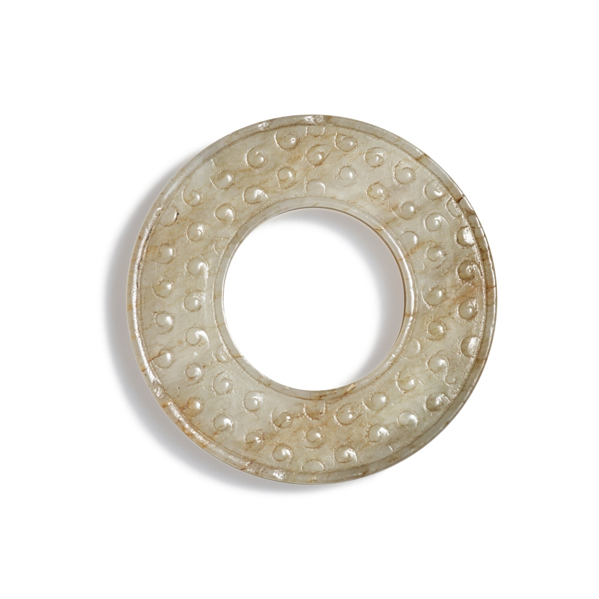 View full screen - View 1 of Lot 100. A small beige jade disc, Warring States period - Han dynasty   戰國至漢 玉穀紋環.
