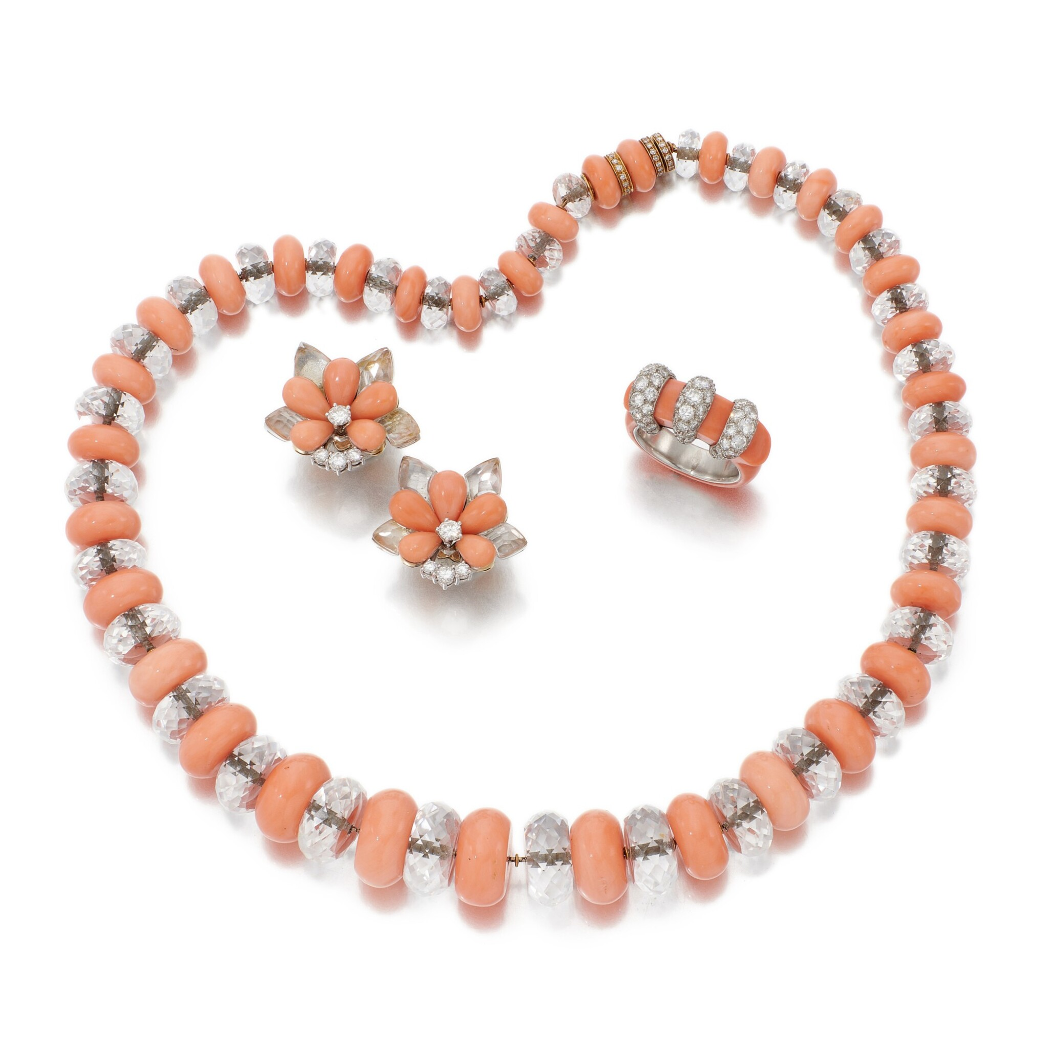 View full screen - View 1 of Lot 70. CORAL AND DIAMOND RING, SIGNED CARTIER, CORAL AND ROCK CRYSTAL NECKLACE AND PAIR OF EARRINGS  (ANELLO IN CORALLO E DIAMANTI, FIRMATO CARTIER, COLLANA E PAIO DI ORECCHINI IN CORALLO, CRISTALLO DI ROCCA E DIAMANTI).