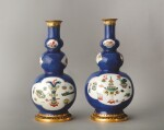 TWO GILT BRONZE-MOUNTED POWDER-BLUE GROUND FAMILLE VERTE TRIPLE GOURD VASES FORMING A PAIR, THE PORCELAIN QING DYNASTY, KANGXI PERIOD (1662-1722), THE MOUNTS MID-18TH CENTURY
