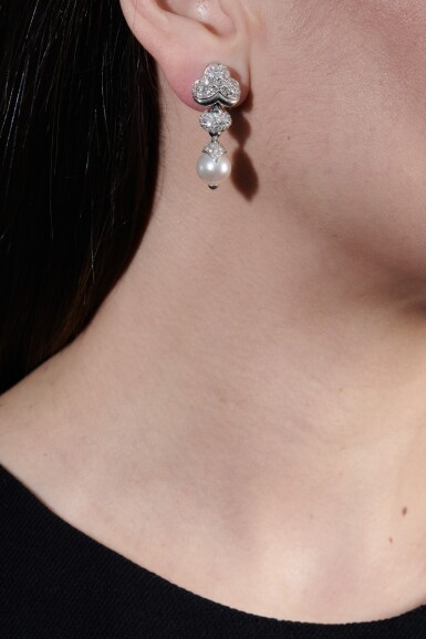View 4. Thumbnail of Lot 1150. Pair of cultured pearls and diamond ear clips.