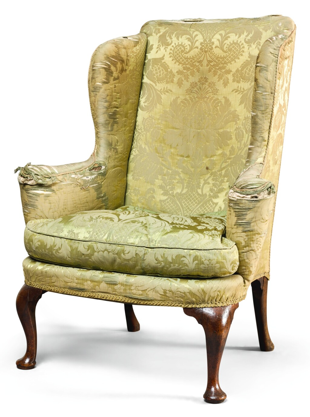A GEORGE I WALNUT WING-BACK ARMCHAIR, CIRCA 1710