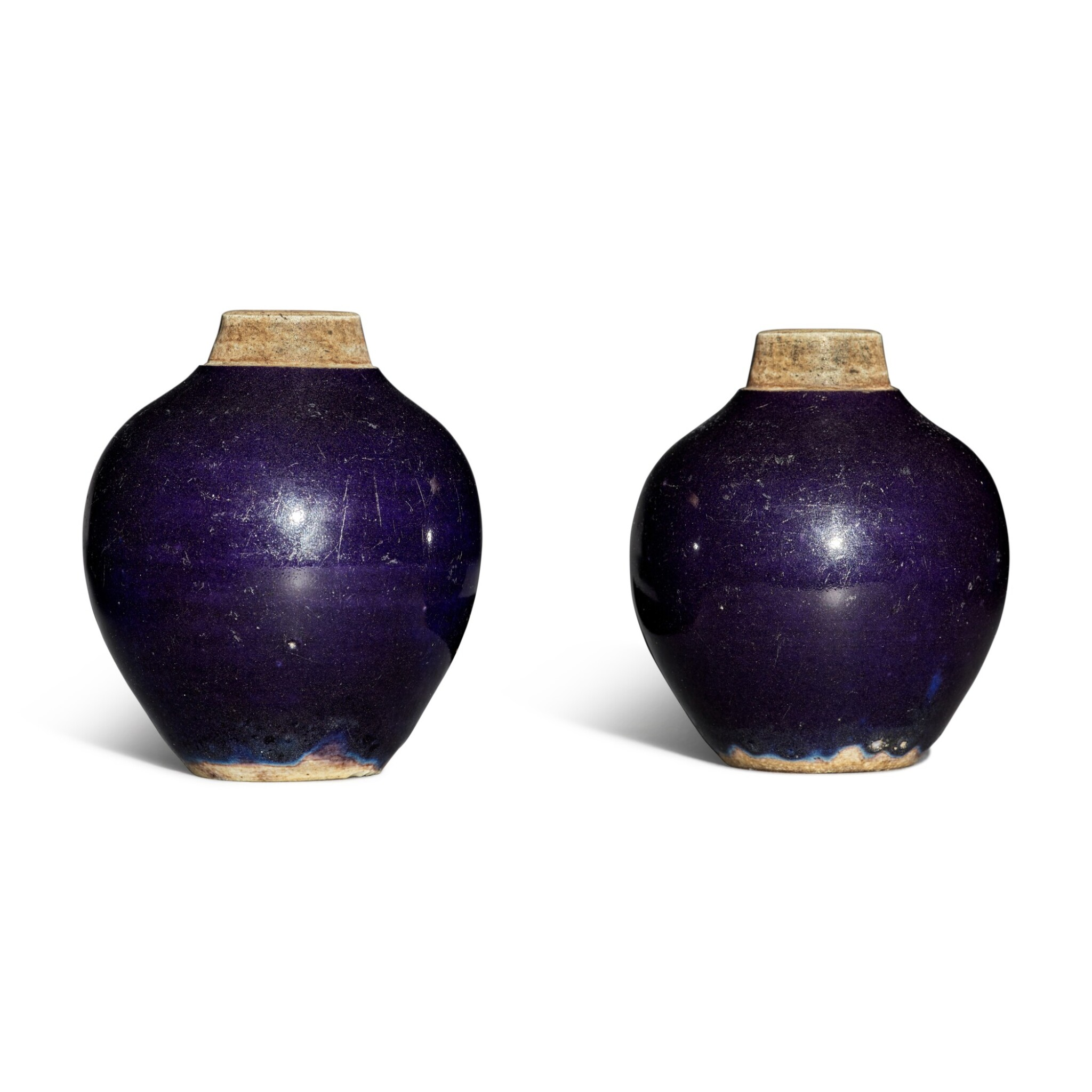View full screen - View 1 of Lot 117. A pair of purple-glazed tea caddies, Qing dynasty.