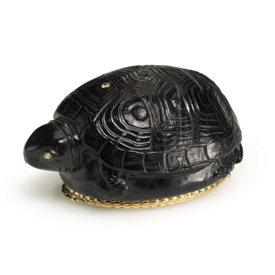 View 2. Thumbnail of Lot 37. A gold-mounted black jasper snuff box in the shape of a turtle, probably German, 19th century.