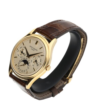 View 3. Thumbnail of Lot 52. PATEK PHILIPPE | REFERENCE 3941 A YELLOW GOLD AUTOMATIC PERPETUAL CALENDAR WRISTWATCH WITH MOON PHASES, CIRCA 1990.