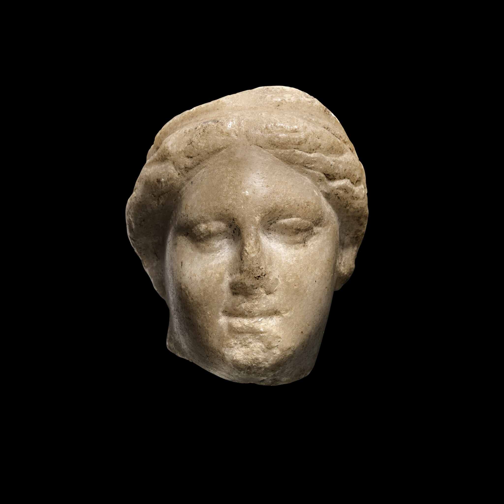 View 1 of Lot 93. A Hellenistic Marble Head of a Goddess, circa 2nd/1st Century B.C..