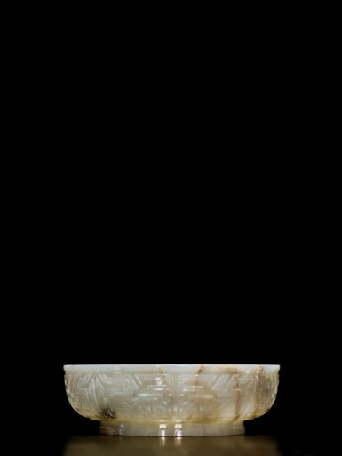 View 4. Thumbnail of Lot 62. An extremely rare inscribed archaistic celadon jade 'twin fish' basin, Mark and period of Qianlong | 清乾隆 青玉雕雙魚盤 《大清乾隆倣古》款.