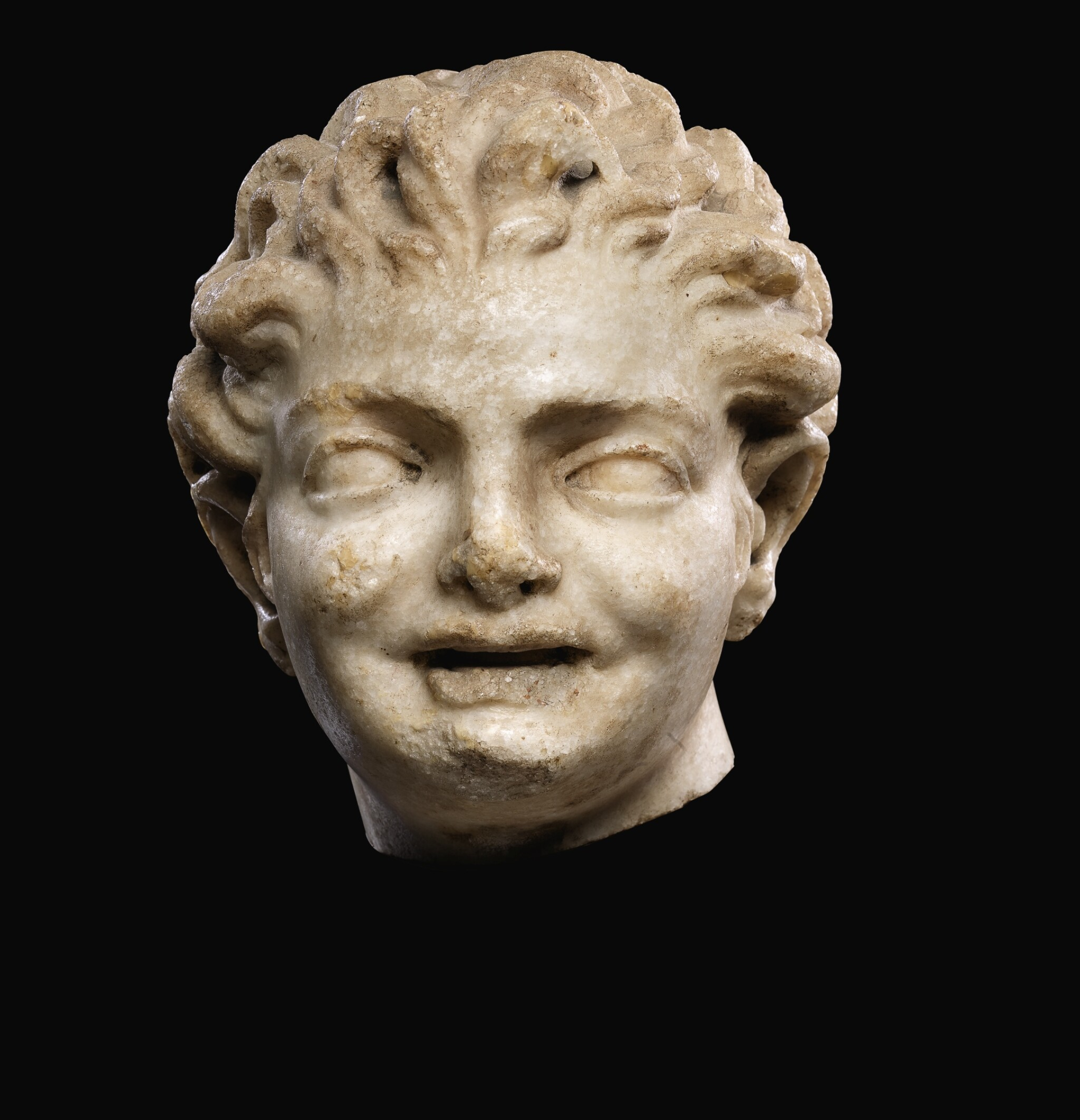 A ROMAN MARBLE HEAD OF A BOY, CIRCA 2ND CENTURY A.D