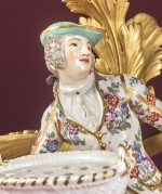 A PAIR OF GILT BRONZE-MOUNTED MEISSEN PORCELAIN BOUQUETIÈRE FIGURE THREE-LIGHT CANDELABRA, 18TH CENTURY, THE PORCELAIN MODELLED BY KÄNDLER AND LATER DECORATED