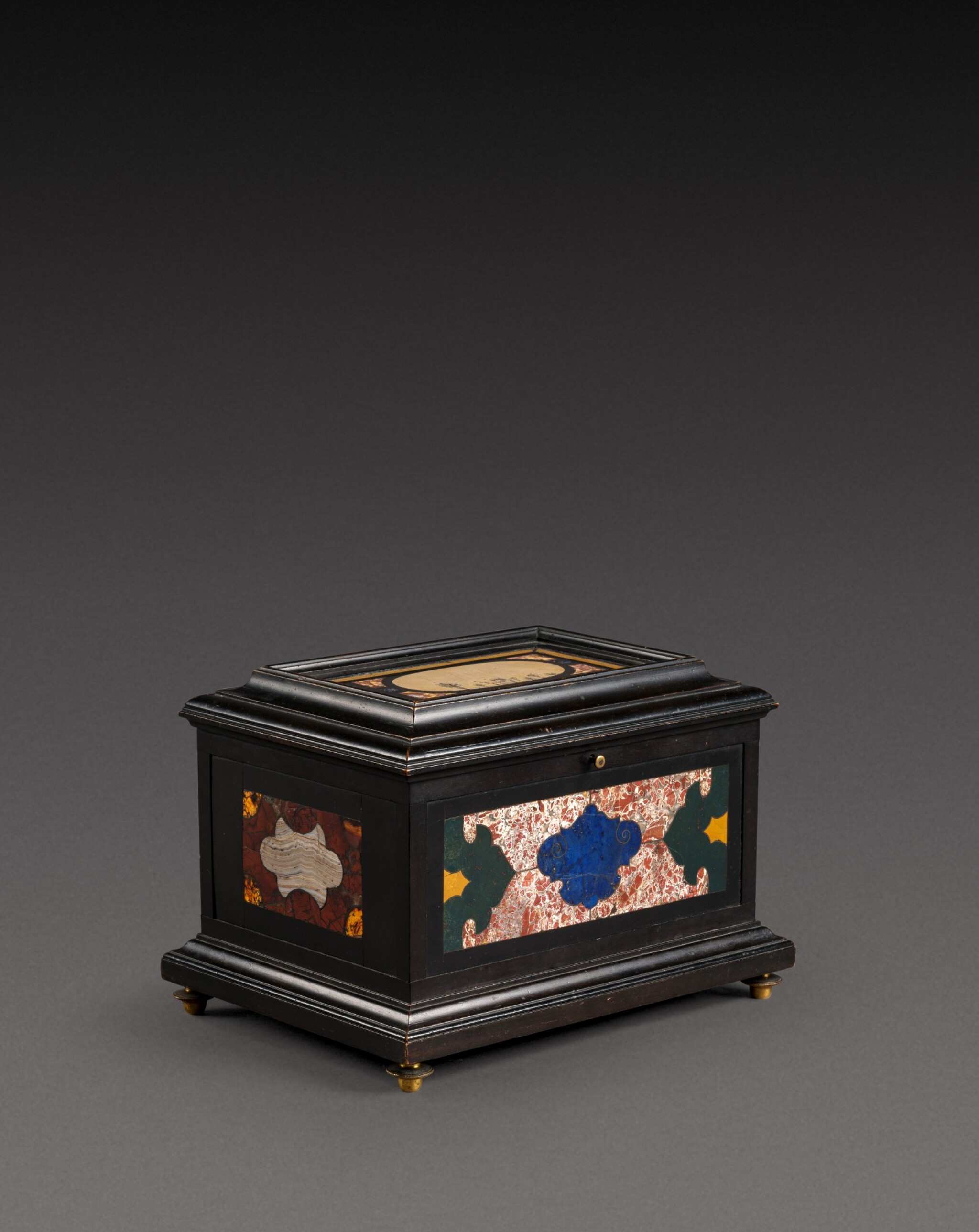 View 1 of Lot 179. An Italian pietra paesina and hardstones inlaid ebonised casket, the panel in the lid, Florence, 18th century, the other panels, Rome and 17th century; the casket late 19th century/early 20th century.