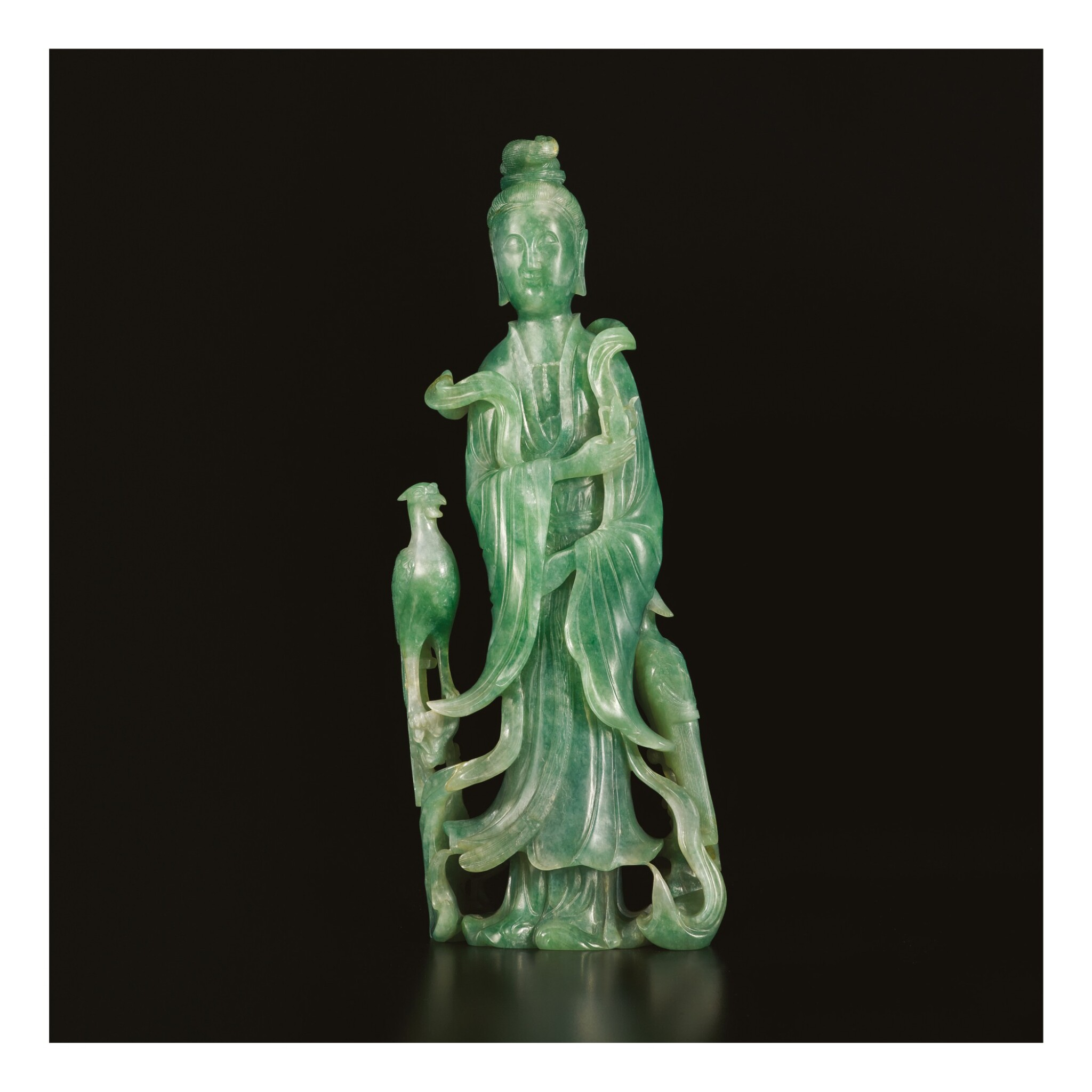 View full screen - View 1 of Lot 672. AN APPLE-GREEN JADEITE FIGURE OF A STANDING MEIREN, LATE QING DYNASTY.