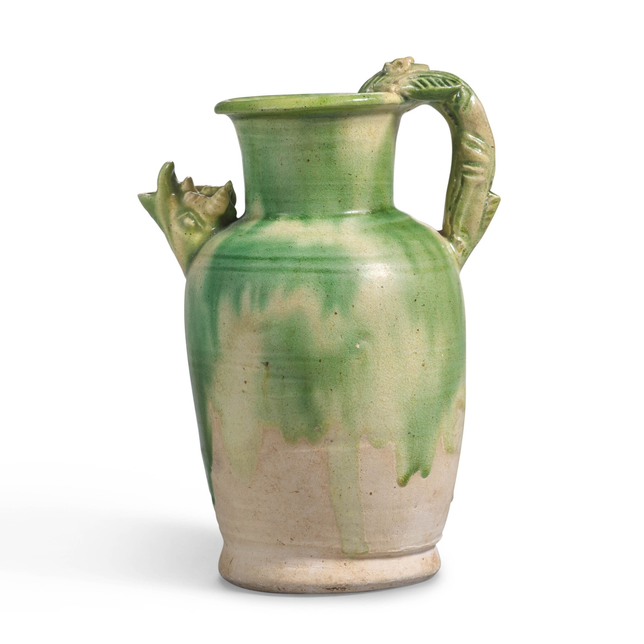 View 1 of Lot 235. A RARE GREEN-SPLASHED 'DRAGON' EWER, TANG DYNASTY | 唐 白釉綠彩龍首執壺.