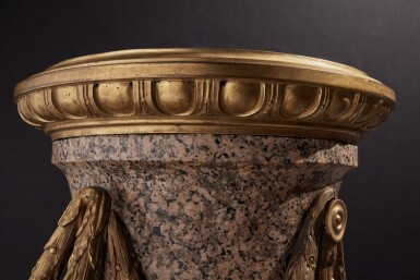 View 7. Thumbnail of Lot 57. A Monumental Pair of Gilt Bronze-Mounted Pink Granite Vases, the Mounts Circa 1840 After Designs by Jean-Louis Prieur or Jean-François Forty; the Vases Possibly Late 18th Century.