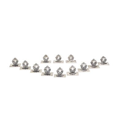 A SET OF TWELVE DANISH SILVER PLACE CARD HOLDERS DESIGNED BY JOHAN ROHDE...