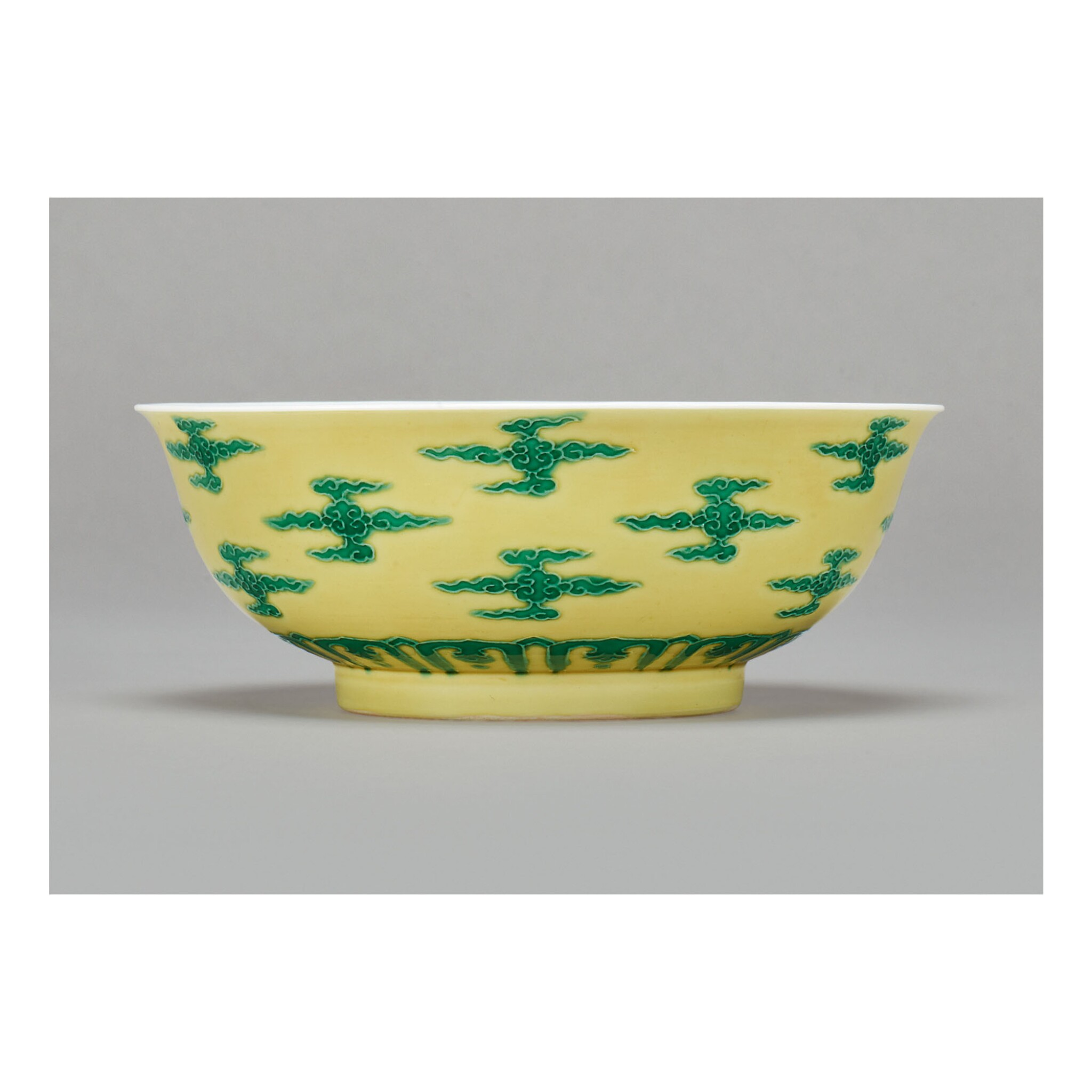 View full screen - View 1 of Lot 106.  A RARE YELLOW-GROUND GREEN-ENAMELED 'CLOUD SCROLL' BOWL , KANGXI MARK AND PERIOD.