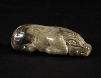 A CALCIFIED JADE PIG HAN DYNASTY OR LATER | 漢或以後 雞骨白玉豚
