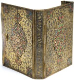 AN ENAMELLED AND NIELLOED BRASS AND SILVER-GILT BINDING, ANATOLIA OR CAUCASUS, LATE 19TH/EARLY 20TH CENTURY